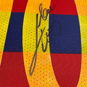messi-2015-2016-signed-shirt-up-close