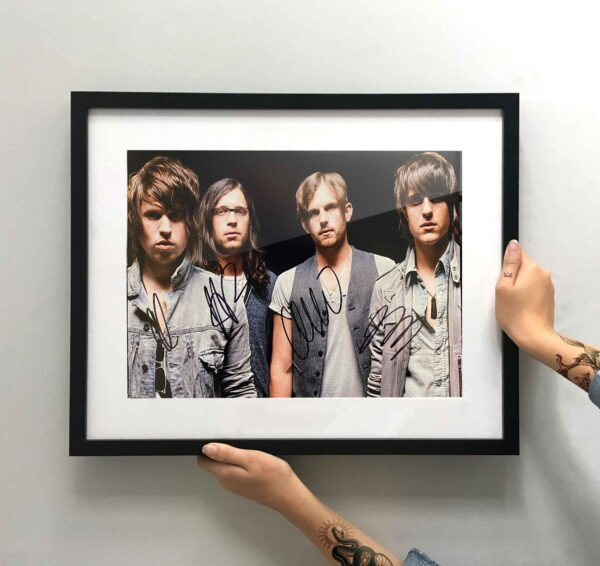 authentically signed kings of leon picture